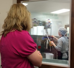 Badger NAMA members watch as milk from the farm is made into ice cream at Kelley Country Creamery